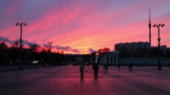 Beautiful sunset in Moscow - square, walking people and Ostankino TV Tower Stock Footage