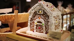 Beautiful and sweet gingerbread house for children in shop Stock Footage
