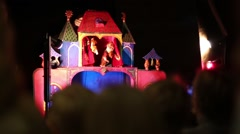 Bright small puppet theater and children heads out of focus Stock Footage