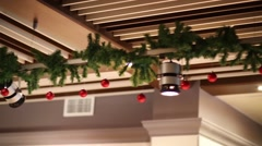 Christmas balls and branches on ceiling - decoration in cafe Stock Footage