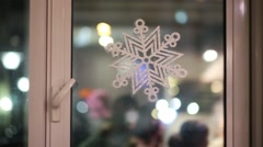 Snowflakes on window glass, shallow depth of field Stock Footage