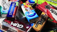 Various brand chewing or bubble gum including Orbit, Dirol, Stock Footage