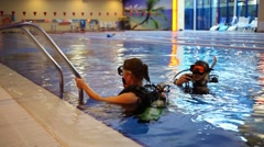 Two people prepare for diving in Kimberley Land diving center Stock Footage