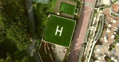 AERIAL: square helicopter parking spot. Camera zooming in.Helicopter parking on Stock Footage