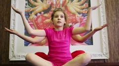 Woman and girl do exercises of yoga as multi-armed god in gym Stock Footage
