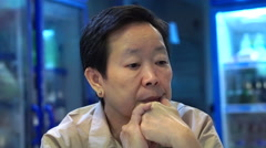 video of Asian senior woman sitting and wait in restaurant - stock footage