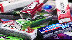 Various brand chewing or bubble gum Stock Footage