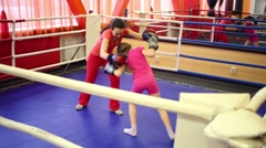 Happy mother and daughter train to boxing in ring in gym Stock Footage
