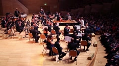 Violinists on stage at concert devoted to 100th anniversary of David Ashkenazy Stock Footage