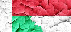 Madagascar flag with Indonesia flag on a grunge cracked wall Stock Illustration