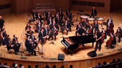 Workers move grand piano at concert in House of Music, Svetlanov hall Stock Footage