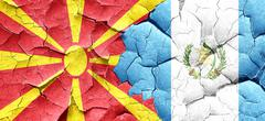 Macedonia flag with Guatemala flag on a grunge cracked wall - stock illustration