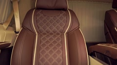 Luxury brown leather car seat tilt close up shot Stock Footage
