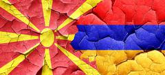 Macedonia flag with Armenia flag on a grunge cracked wall Stock Illustration
