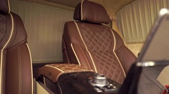 Luxury brown leather and yellow trimming car interior with installed tablet, pan - stock footage