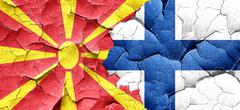 Macedonia flag with Finland flag on a grunge cracked wall Stock Illustration