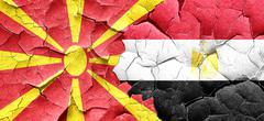 Macedonia flag with egypt flag on a grunge cracked wall - stock illustration