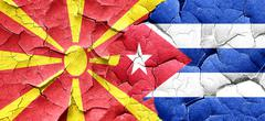Macedonia flag with cuba flag on a grunge cracked wall Stock Illustration