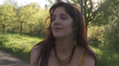 A lady listening to the sounds of the nature in a park in Prague Stock Footage