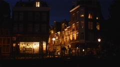 Amsterdam at night: streetcorner by canal Stock Footage