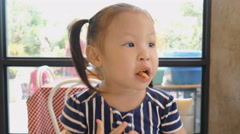 Little girl eating french fries - stock footage