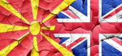 Macedonia flag with Great Britain flag on a grunge cracked wall Stock Illustration
