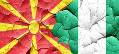 Macedonia flag with Nigeria flag on a grunge cracked wall Piirros
