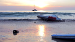 Inflatable upturned boat near the beach Stock Footage