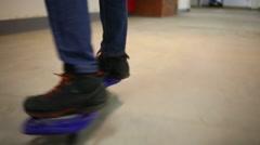 Closeup of boy feet riding on waveboard in underground parking Stock Footage