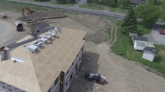 4k aerial roofers installing shingles Stock Footage