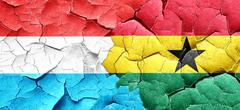 Luxembourg flag with Ghana flag on a grunge cracked wall Stock Illustration