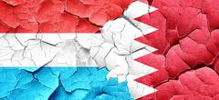 Luxembourg flag with Bahrain flag on a grunge cracked wall Stock Illustration