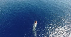 AERIAL: motorboat start in the blue sea Stock Footage