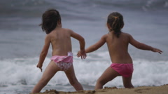 small children looking at the waves - stock footage