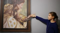 Girl touches hand of woman on picture in optical illusions Museum Stock Footage