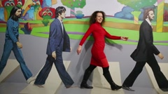 Woman goes with Beatles in optical illusions Museum at VDNKh Stock Footage