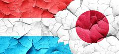 Luxembourg flag with Japan flag on a grunge cracked wall - stock illustration