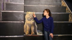 Girl sits with cat in optical illusions Museum at VDNKh Stock Footage
