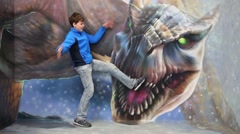 Boy with legs in dragon mouth in optical illusions Museum Stock Footage