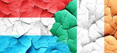 Luxembourg flag with Ireland flag on a grunge cracked wall - stock illustration
