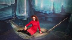 Woman sits on narwhal in optical illusions Museum at VDNKh Stock Footage