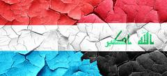 Luxembourg flag with Iraq flag on a grunge cracked wall Stock Illustration