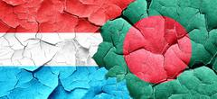 Luxembourg flag with Bangladesh flag on a grunge cracked wall Stock Illustration