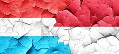 Luxembourg flag with Indonesia flag on a grunge cracked wall - stock illustration
