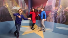Woman, boy sing and girl dances on stage in optical illusions Museum Stock Footage