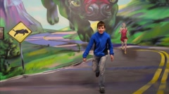 Boy runs away from monster in optical illusions Museum Stock Footage