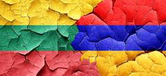 Lithuania flag with Armenia flag on a grunge cracked wall - stock illustration