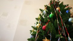 Many shiny christmas balls and toys on tree in home, close up Stock Footage