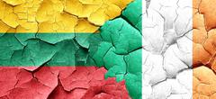 Lithuania flag with Ireland flag on a grunge cracked wall Piirros