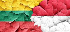 Lithuania flag with Indonesia flag on a grunge cracked wall - stock illustration